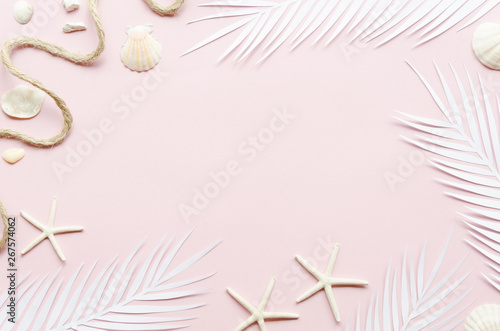 Fototapeta Frame of palm leaves and sea stars obraz na płótnie