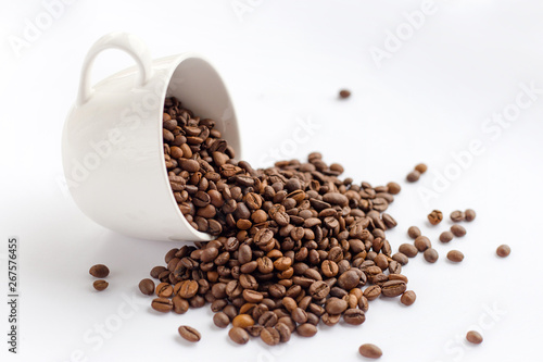 Coffee beans in white cup isolated on white background, drinks concept