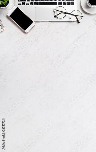 Tuinposter Betonbehang Business financial design concept, marble white office table desk top view with smart phone, mockup credit card, coins, laptop, flat lay, copy space