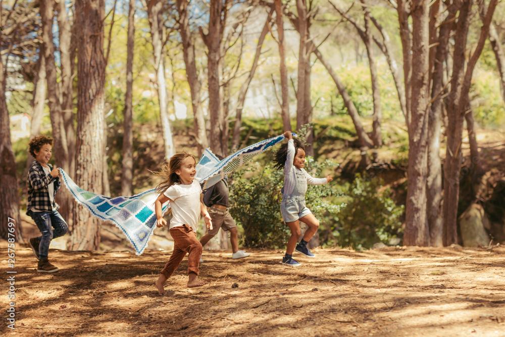 Fototapeta Kids enjoying together in park