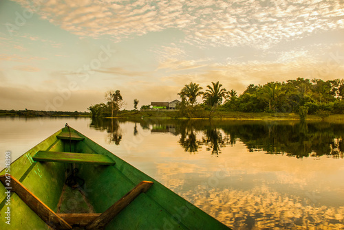 Cadres-photo bureau Brésil Beautiful sunrise on the river. View from the boat at Amazon river, with a dense forest on the shore and blue sky, Anazonas, Brazil