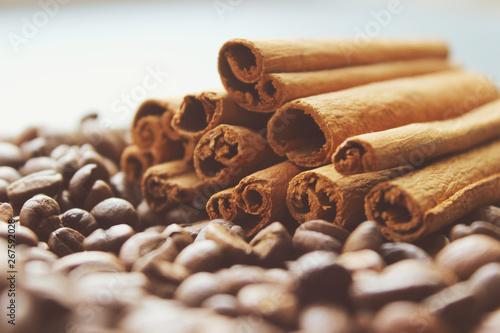 Cinnamon sticks and coffee beans closeup. Aromatic coffee - coffee beans and cinnamon sticks. Background. Copy space.