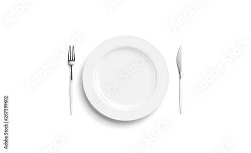 Obraz na plátně  Blank white plate mockup with fork and knife, side view isolated, 3d rendering