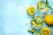 canvas print picture - Summer citrus cocktail or lemonade with rosemary. Top view with copy space.