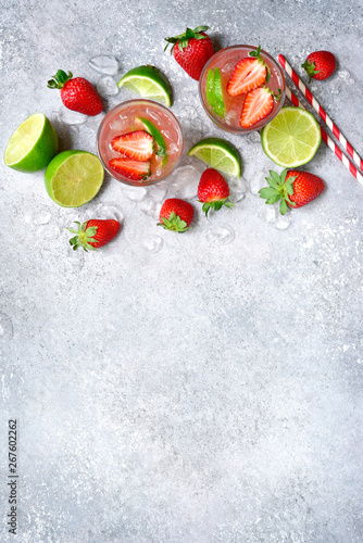 Homemade strawberry lemonade with lime. Top view with copy space.