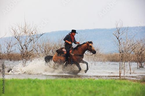 Acrylic Prints Horseback riding Cowboy ride horse Run through the water