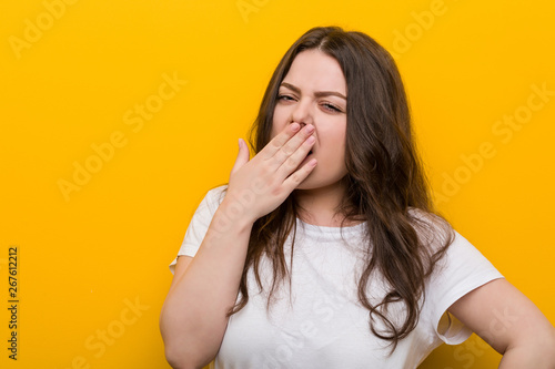 Valokuvatapetti Young curvy plus size woman yawning showing a tired gesture covering mouth with him hand