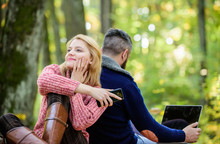 Couple In Love Relax In Autumn Forest With Phone And Laptop. Happy Girl Dreaming Outdoor. Man Sit With Back. Spring Mood. Camping And Hiking. Family Picnic. Relationship. Full Concentration At Work