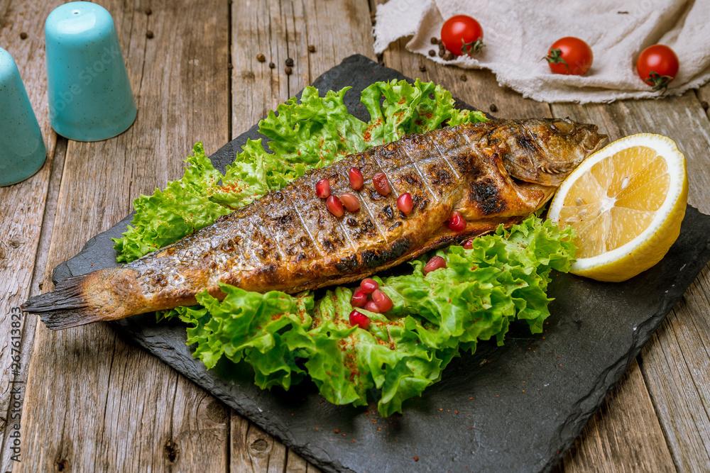 Fototapety, obrazy: Fried sea bass on board