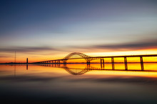 Long Silhouetted Bridge With A...