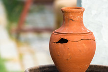 Broken Clay Jug With Large Hol...
