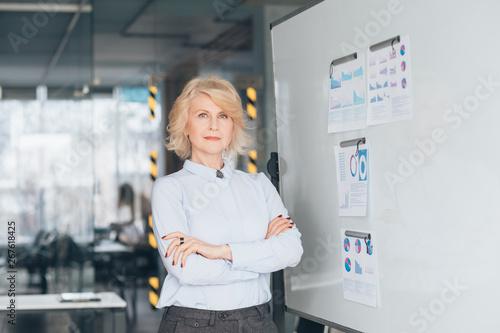Confident business woman waist up Wallpaper Mural