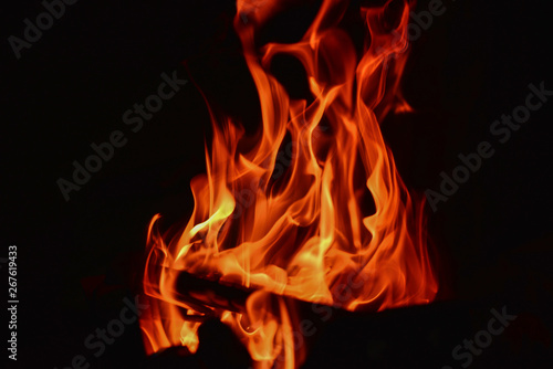 The fiery burning flame on a black background