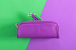 Leinwandbild Motiv Back to school. Colorful minimal composition of school supplies on green and purple background. Flat lay, top view, copy space