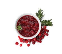 Bowl Of Cranberry Sauce With Rosemary On White Background, Top View