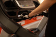 Closeup shot of woman on treadmill at gym