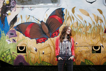 Smiling Teenage Girl Standing At A Painted Train Car