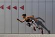 Leinwandbild Motiv Woman running on sidewalk. Urban background