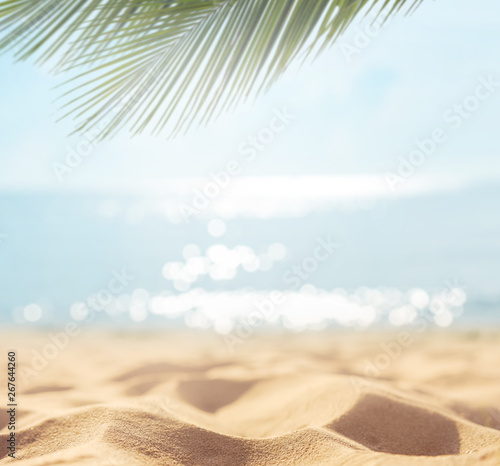 Obraz Sand with blurred Palm and tropical beach bokeh background, Summer vacation and travel concept. Copy space. - fototapety do salonu
