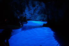 Tourists Inside Blue Cave, Bisevo Island - Croatia.