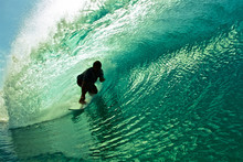Surfer Silhouette Riding Wave ...