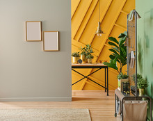 Home Room Interior Style With Brown And Yellow Background, Wooden Table, Vase Of Plant.
