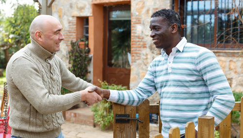 Fotografie, Obraz  Getting to know the neighbors at the country houses in village