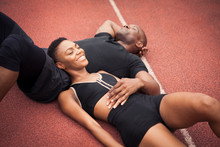 Smiling Athlete Couple Relaxin...