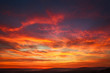 canvas print picture Gorgeous orange sunset colorful clouds in evening sky, natural beauty of nature