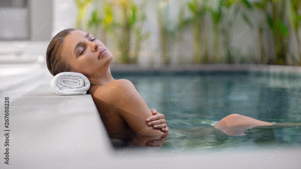 Fototapety, obrazy: Young beautiful girl enjoying spa treatment in the pool