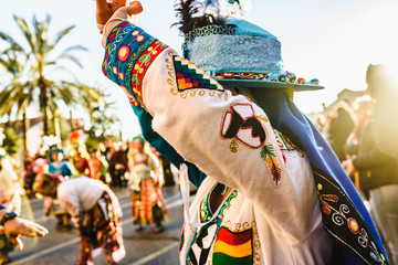 Valencia, Spain - February 16, 2019: Woman performing the Bolivian folk dance the Tinku dressed in folkloric and colorful traditional dress during the carnival of the Ruzafa district in Valencia.