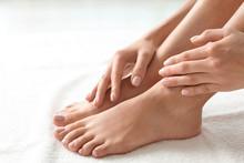 Woman With Beautiful Feet On White Towel, Closeup. Spa Treatment