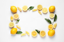 Frame Made Of Lemons, Leaves And Flowers On White Background, Top View With Space For Text. Citrus Fruits