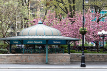 New York City Subway Station Entrance In Union Square Park With Colorful Spring Flowers