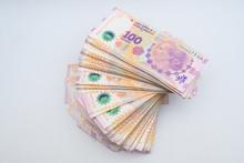 Money On White Backdrop. Big Pile Of Argentinian Pesos