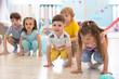 canvas print picture - Crouching children prepared to jump. Sport activities