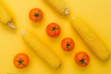 Tomatoes And Corn On A Yellow ...