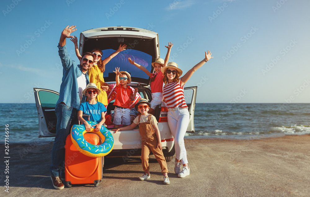 Fototapeta happy large family  in summer auto journey travel by car on beach.