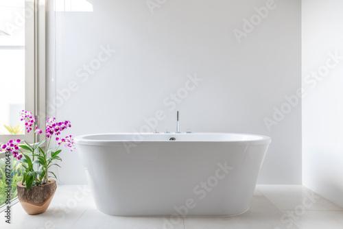 Fotografie, Tablou Luxury bathroom features bathtub with flower