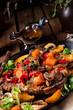 Leinwandbild Motiv tender beef topped with various vegetables
