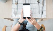 Hand Holding Mobile Blank Screen Over Restaurant Table Order Food Online.mock Up Screen For Display Of Design