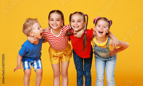Poster de jardin Individuel group of cheerful happy children on colored yellow background.