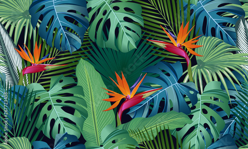 Seamless pattern tropical leaves with bird of paradise on black background