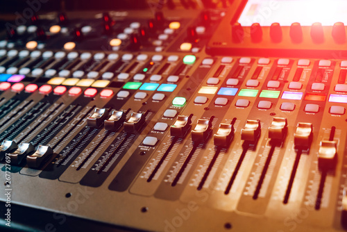 Remote sound engineer. Many buttons of black audio mixer board console. Music equipment. Close-up - 267727697