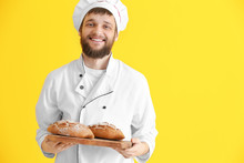 Young Baker With Fresh Bread O...