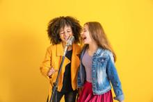 Teenage Girls With Microphone ...