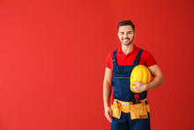 Male Electrician On Color Background