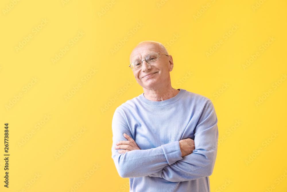 Fototapety, obrazy: Portrait of happy elderly man on color background