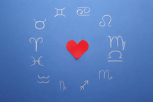 Zodiac Signs And Red Heart On Color Background. Love Horoscope Concept