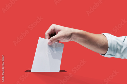Obraz na plátně  Hand holding ballot paper for election vote concept, clipping path Isolated